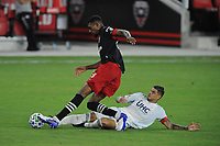 WASHINGTON, DC - AUGUST 25: Donovan Pines #23 of D.C. United battles for the ball with Gustavo Bou #7 of New England Revolution during a game between New England Revolution and D.C. United at Audi Field on August 25, 2020 in Washington, DC.