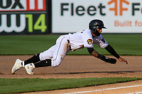 Wisconsin Timber Rattlers outfielder Carlos Rodriguez (3) dives back to first base during a game against the West Michigan Whitecaps on May 22, 2021 at Neuroscience Group Field at Fox Cities Stadium in Grand Chute, Wisconsin.  (Brad Krause/Four Seam Images)