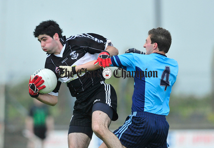 Doonbeg's David Tubridy gathers the ball ahead of Thomas Donnellan of Cooraclare. Photograph by Declan Monaghan