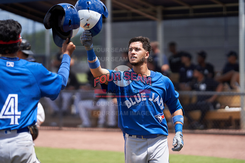 FCL Blue Jays Glenn Santiago (49) celebrates hitting a home run during a game against the FCL Yankees on June 29, 2021 at the Yankees Minor League Complex in Tampa, Florida.  (Mike Janes/Four Seam Images)