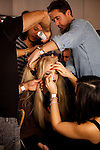 NEW YORK  --  FEBRUARY 12, 2011:  Hair Stylist Paul Hanlon (top right) and crew get Daphne Groeneveld's hair ready for Joseph Altuzarra's show backstage at Milk Studios during New York Fashion Week on February 12, 2011.  (PHOTOGRAPH BY MICHAE NAGLE)