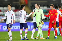 SWANSEA, WALES - NOVEMBER 12: Johnny #16 of the United States and Danny Ward #1 of Wales congratulate one another during a game between Wales and USMNT at Liberty Stadium on November 12, 2020 in Swansea, Wales.