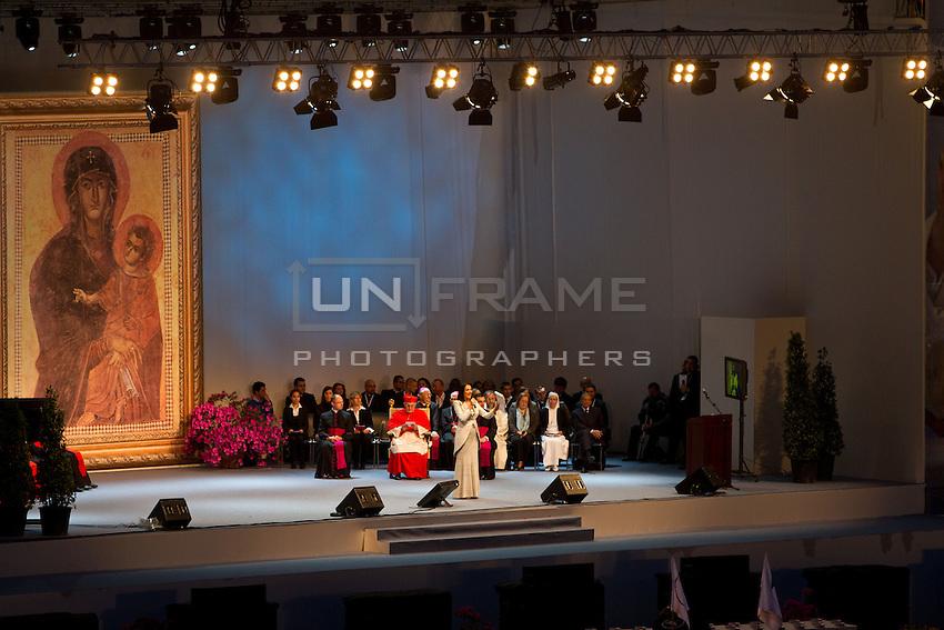 Journalist Safiria Leccese presents the event on the stage followed by ex-spokesman of Wojtyla, Joaquin Navarro Valls.