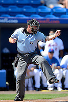 Home plate umpire Brian Child makes a call during a spring training game between the New York Mets and Michigan Wolverines at Tradition Field on February 24, 2013 in St. Lucie, Florida.  New York defeated Michigan 5-2.  (Mike Janes/Four Seam Images)