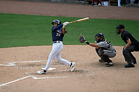 Third baseman Brandon Howlett (35) of the Greenville Drive bats in a game against the Delmarva Shorebirds on Friday, August 2, 2019, in the continuation of rain-shortened game begun August 1, at Fluor Field at the West End in Greenville, South Carolina. The catcher is Cody Roberts and the umpire is Ben Engstrand. Delmarva won, 8-5. (Tom Priddy/Four Seam Images)