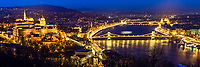 Iconic Budapest buildings panorama from Gellert Hill, with the palace, Mathias Church, Chain bridge, and the parliament lit up at twilight, Hungary