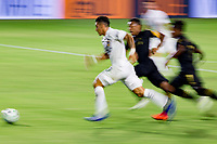 CARSON, CA - SEPTEMBER 06: Cristian Pavon #10 of the Los Angeles Galaxy moves with the ball during a game between Los Angeles FC and Los Angeles Galaxy at Dignity Health Sports Park on September 06, 2020 in Carson, California.