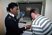 Driver blowing into a breathalyzer machine. It is kept at police stations and used when it is required to provide a further breath test that is more accurate than the reading given by the handheld units that are used on the roadside. This image may only be used to portray the subject in a positive manner..©shoutpictures.com..john@shoutpictures.com