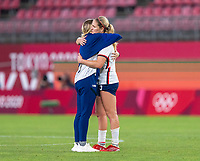 KASHIMA, JAPAN - AUGUST 2: Abby Dahlkemper #17 of the USWNT and Lindsey Horan #9 of the USWNT embrace after the game between Canada and USWNT at Kashima Soccer Stadium on August 2, 2021 in Kashima, Japan.