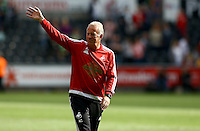 Swansea City first team coach Alan Curtis waves to the fans at full time during the Barclays Premier League match between Swansea City and Manchester City played at The Liberty Stadium, Swansea on 15th May 2016