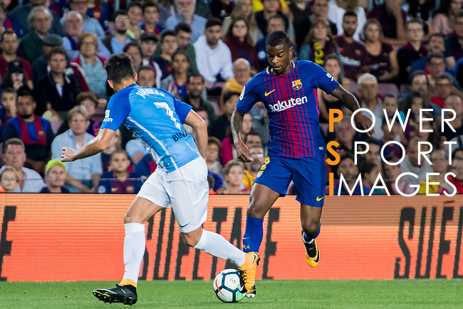 Nelson Cabral Semedo of FC Barcelona fights for the ball with Juan Carlos Perez Lopez, Juankar, of Malaga CF during the La Liga 2017-18 match between FC Barcelona and Malaga CF at Camp Nou on 21 October 2017 in Barcelona, Spain. Photo by Vicens Gimenez / Power Sport Images