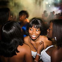 Recently graduated young women share a joke during a graduation party at the Agostinho Neto University's (Universidade Agostinho Neto) law faculty.