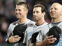 """Syracuse Chiefs Starting Pitcher Stephen Strasburg (37 - left) laughs along with Josh Whitesell (middle) and Kelvin Mench (right) before """"God Bless America"""" in the 7th inning during a game vs. the Rochester Red Wings Wednesday, May 19, 2010 at Frontier Field in Rochester, New York.   Syracuse defeated Rochester by the score of 5-1 as Strasburg earned his third win at the Triple-A level with no losses.  Photo By Mike Janes/Four Seam Images"""
