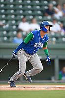 Shortstop Jeison Guzman (11) of the Lexington Legends follows through on a swing during a game against the Greenville Drive on Saturday, September 1, 2018, at Fluor Field at the West End in Greenville, South Carolina. Greenville won, 9-6. (Tom Priddy/Four Seam Images)