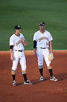 Bradenton Marauders shortstop Kevin Newman (5) and second baseman Kevin Kramer (14) during warmups in between innings during a game against the Fort Myers Miracle on April 9, 2016 at McKechnie Field in Bradenton, Florida.  Fort Myers defeated Bradenton 5-1.  (Mike Janes/Four Seam Images)