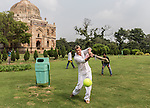 8 October 2013, New Delhi, India. Recently retired Australian cricket star Brett Lee shows off his old skills with a scratch game of tennis ball cricket in front of a Mughal era tomb in the famous Lodi Gardens in New Delhi. His arrival caused great interest in the local boys in the grounds. He is in India to show off his latest fashion lines and to foster greater interest in Australian - Indian business interactions.  Picture by Graham Crouch
