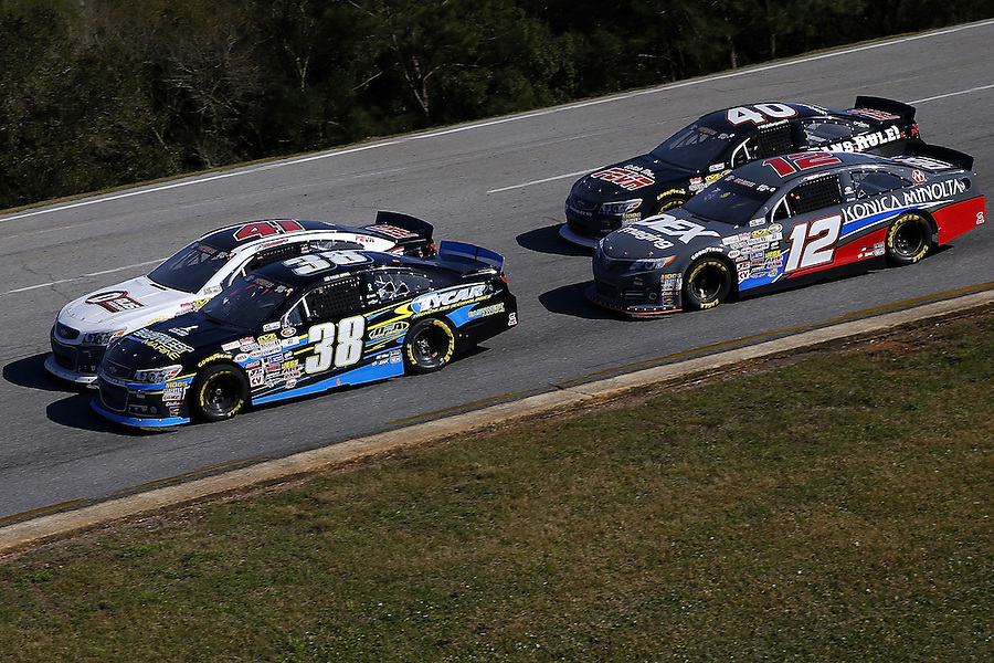 MOBILE, AL - MARCH 13: Tyler Dippel, driver of the #38 East West Marine/TyCar Chevrolet, leads a pack of cars during the NASCAR K&N Pro Series East Mobile 150 on March 13, 2016 in Mobile, Alabama.  (Photo by Jonathan Bachman/NASCAR via Getty Images)