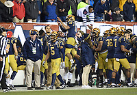PHILADELPHIA, PA - DEC 14, 2019: Navy Midshipmen quarterback Malcolm Perry (10) is hoisted up by Navy Midshipmen guard Niko Yaramus (66) after a touchdown during game between Army and Navy at Lincoln Financial Field in Philadelphia, PA. The Midshipmen defeated Army 31-7. (Photo by Phil Peters/Media Images International)