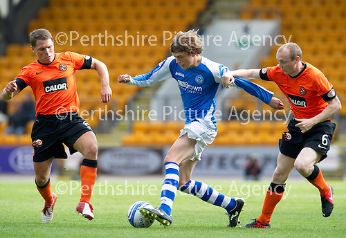 St Johnstone v Dundee United....01.09.12      SPL  .Murray Davidson is closed down by John Rankin and Willo Flood.Picture by Graeme Hart..Copyright Perthshire Picture Agency.Tel: 01738 623350  Mobile: 07990 594431