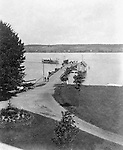 Lakewood NY: View of the Kent House pier from the Hotel.  A Chautauqua Lake touring boar arriving at the pier. Photographs were taken during a church field trip to Chautauqua Institution in New York (Lake Chautauqua). The Stewart family and friends visited Chautauqua during 1901 to hear Stewart's relative, Dr. S.H. Clark speak at the institute. Alice Brady Stewart chaperoned and Brady Stewart came along to photograph the trip.  The Gallery provides a glimpse of how the privileged and church faithful spent summers at Lake Chautauqua at the turn of the century.