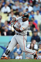 Pablo Sandoval #48 of the San Francisco Giants bats against the Los Angeles Dodgers at Dodger Stadium in Los Angeles,California on April 3, 2011. Photo by Larry Goren/Four Seam Images