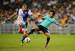 SO KON PO, HONG KONG - JULY 30: Vince Grella of Blackburn Rovers and Lo Kwan Yee of Kitchee in action during the Asia Trophy pre-season friendly match at the Hong Kong Stadium on July 30, 2011 in So Kon Po, Hong Kong.  Photo by Victor Fraile / The Power of Sport Images