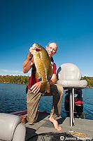 Man hoisting smallmouth bass