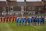 Shildon 0 Warrington Rylands 0 (4-5 pens), 17/04/2021. Dean Street, FA Vase Fourth Round. The players observe a minute's silence for a club official before Shildon (in red) take on Warrington Rylands in an FA Vase Fourth Round tie at Dean Street. Formed in 1890, the home club are members of the Northern League Division One with their rivals playing in the North West Counties League Premier Division. The away team won the match 5-4 on penalties after a 0-0 draw over 90 minutes, in a fixture played without spectators permitted due to ongoing Covid-19 restrictions. Photo by Colin McPherson.