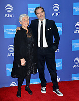 PALM SPRINGS03, 2020: Arlyn Phoenix & Joaquin Phoenix at the 2020 Palm Springs International Film Festival Film Awards Gala.<br /> Picture: Paul Smith/Featureflash
