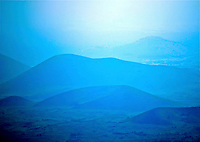 The blue hills to Mauna Kea seen on a drive up the road, to the majestic mountain, on the island of Hawai'i.