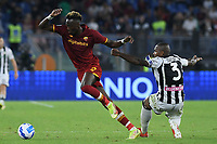 23rd September 2021;  Stadio Olimpicom, Roma, Italy; Serie A League Football, Roma versus Udinese; Tammy Abraham of AS Roma skips past the tackle of Samir of Udinese