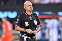 Match referee Heber Lopez reacts after the end of regulation time during Copa America Centenario final, Sunday, June 26, 2016 in East Rutherford, New Jersey. Chile won 4-2 on penalty kicks. (TFV Media via AP) *Mandatory Credit*