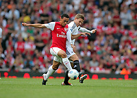Pictured: Mark Gower of Swansea (R) is challenged by Francis Coquelin of Arsenal (L). Saturday 10 September 2011<br />