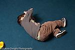 Education preschool 3-4 year olds emotion temper tantrum sad boy kicking and rolling on floor horizontal
