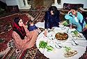 Syria 2000 <br /> A wealthy Kurdish family of Qamishli having lunch in their living-room   <br /> Syrie 2000 Une famille kurde aisée dejeunant dans leur salon a Qamishli