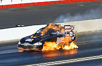 Feb 8, 2015; Pomona, CA, USA; NHRA funny car driver Jeff Arend explodes a fuel tank causing a fire during the Winternationals at Auto Club Raceway at Pomona. Arend was uninjured in the explosion. Mandatory Credit: Mark J. Rebilas-USA TODAY Sports