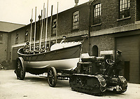 BNPS.co.uk (01202 558833)<br /> Pic: Sport&GeneralPressAgency/RNLI<br /> <br /> Launching drill at the RNLI's Poplar Depot in the 1930's.<br /> <br /> Splash in the Attic...<br /> <br /> A 'lost' cache of 13,000 photographs charting the history of the RNLI has been found in the attic of the charity's headquarters.<br /> <br /> Many of the black and white photos date back to the 1920s and '30s long before the terms 'health and safety' and 'risk assessment' were thought of.<br /> <br /> One image depicts a brave lifeboatman dressed in a suit and cloth cap just as the lifeboat he is on launches down a ramp into a choppy sea.<br /> <br /> Another shows the crew of another open lifeboat getting swamped by waves with only their souwesters and lifejackets to protect them.<br /> <br /> The photos have been unearthed in storage space at the RNLI HQ in Poole, Dorset, and they are now being digitised.