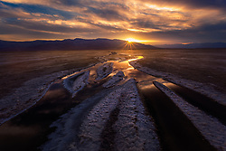 Reflected light of sunset on the salt lined flats of Death Valley.