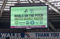 Rivals on the pitch united against racism on the big screen the Sky Bet Championship match between Swansea City and Cardiff City at the Liberty Stadium in Swansea, Wales, UK. Saturday 20 March 2021