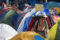 Fórum Social Mundial 2009.<br /> Milhares de participantes estão instaladas em grandes <br /> acampamentos organizados em meio<br /> a um seringal na Ufra – Universidade Federal Rural <br /> da Amazônia(um dos locais do evento) no dia de abertura do <br /> Fórum Social Mundial 2009.<br /> Foto Paulo Santos<br /> Belém, Pará, Brasil.<br /> 27/01/2009