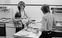 Cooking class at the Education Centre, Wester Hailes, Scotland, 1979.  John Walmsley was Photographer in Residence at the Education Centre for three weeks in 1979.  The Education Centre was, at the time, Scotland's largest purpose built community High School open all day every day for all ages from primary to adults.  The town of Wester Hailes, a few miles to the south west of Edinburgh, was built in the early 1970s mostly of blocks of flats and high rises.