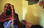 INDIA (West Bengal - Calcutta) - Geeta Das an Aids patient at her room in Saheb bagan red light area. Geeta died few weeks later after this photo was taken. - Arindam Mukherjee