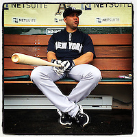 OAKLAND, CA - JUNE 15:  Instagram of Carlos Beltran of the New York Yankees sitting in the dugout before the game against the Oakland Athletics at O.co Coliseum on June 15, 2014 in Oakland, California. Photo by Brad Mangin