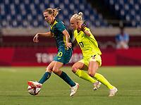 TOKYO, JAPAN - JULY 24: Emily van Egmond #10 of Australia holds the ball away from Caroline Seger #17 of Sweden during a game between Australia and Sweden at Saitama Stadium on July 24, 2021 in Tokyo, Japan.