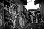 A lane at Kumortuli. Kumortuli in North Calcutta is the hub of religious idol makers. During the other time of the year the artists engage themselves in prepairing other idols and masks depending on the assignments.