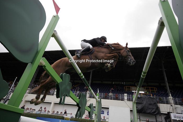 August 09, 2009: Thomas Ryan (IRL) aboard Urleven Van De Helle competing in the Grand Prix event. Longines International Grand Prix. Failte Ireland Horse Show. The RDS, Dublin, Ireland.