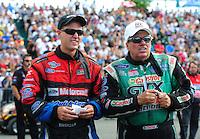 Aug. 7, 2011; Kent, WA, USA; NHRA funny car driver Bob Tasca III (left) talks with John Force during the Northwest Nationals at Pacific Raceways. Mandatory Credit: Mark J. Rebilas-