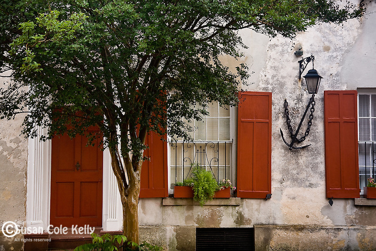 A stucco house with Red shutters in Charleston, SC, USA