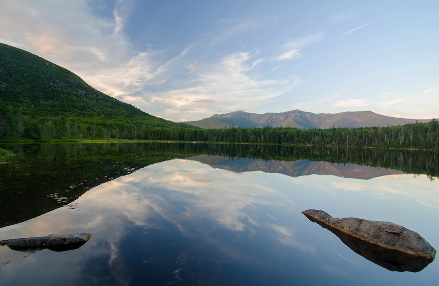 The calm water of Lonesome Lake reflects Franconia Ridge near perfectly on an early summers eve.