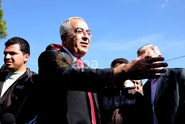 Palestinian Prime Minister Salam Fayyad participates in a protest for the disabled in front of his office in the West Bank city of Ramallah on Dec 23, 2009. Photo by Issam Rimawi